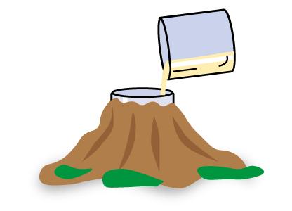 Añadimos el vaso de vinagre al volcán para empezar la reacción